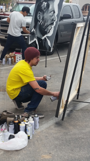 """Celia Shortt Goodyear/Boulder City Review Artist Lee Hendrickson creates a painting of Scorpion from the movie """"Mortal Kombat Rebirth"""" outside the historic Boulder Theatre during the 13th annual D ..."""