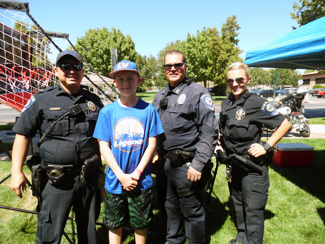 Hunter Terry/Boulder City Review Clark County School District police officers Juan Wibowo, from left, Shane Burton and Carole Farasy shot some hoops and played games with 12-year-old Adam Bennett  ...