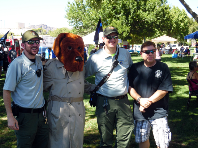 Hunter Terry/Boulder City Review Lake Mead emergency medical service officers Peter Seltzer, from left, Joey Kasura and Thomas Perkins mingled with supporters including McGruff the Crime Dog on Sa ...