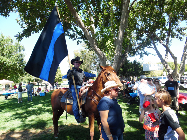 Hunter Terry/Boulder City Review Rafael Sarabia, riding his chestnut mare Red Sonia, is a big fan of law enforcement and said he was thrilled to be invited to carry the Thin Blue Line flag in thei ...