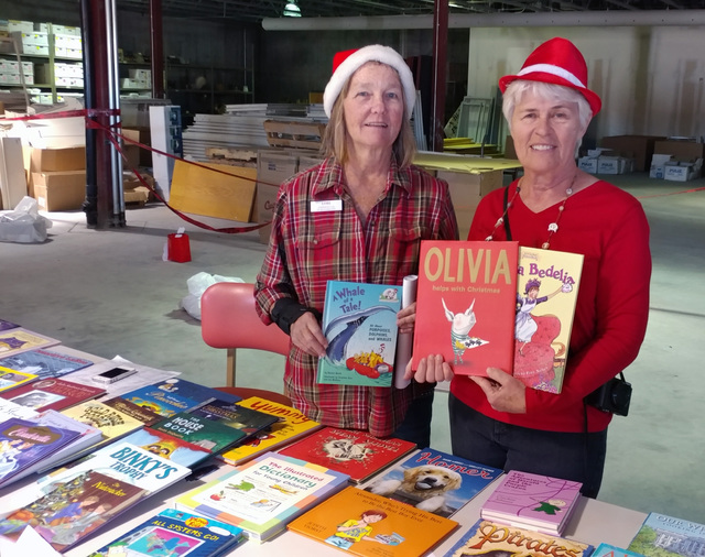 Hunter Terry/Boulder City Review Lori McHugh, left, and Jan Barbour helped organize and oversee Emergency Aid of Boulder City's Angel Tree program this year, which saw hundreds gifts, including bo ...