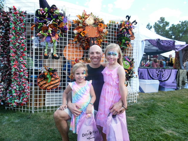 Hunter Terry/Boulder City Review Ken Kunke brought daughters Morgan, 4, left, and Madilyn, 7, to Boulder City for their first Art in the Park experience Saturday, the 54th anniversary for the Boul ...