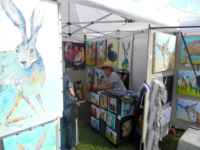 Hunter Terry/Boulder City Review This was Brenda Pe'o's third year as a vendor at Art in the Park, where she said this year's crowd was extremely responsive to her animal paintings Saturday and sh ...