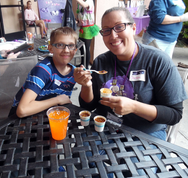 Hunter Terry/Boulder City Review Nathan and Charlene Hampton supported the Relay for Life of Boulder City and enjoyed tasting the entries Saturday at the chili cook off to support the American Can ...