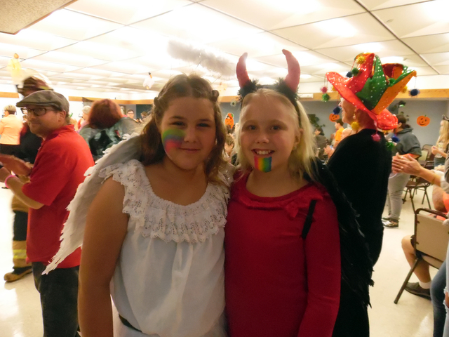 Mia Helton, 12, and Siarra Johnson, 11, shared first place honors among the older division of children in the costume contest Friday at the senior center's Family Fun Night. Hunter Terry/Boulder ...
