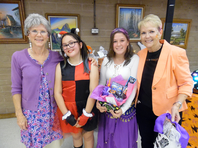 Robin Rease, Monika Arroway, 12, along with Rory Leavitt, 13, and councilwoman Peggy Leavitt were the two winning teams of the adult/child dance contest Friday at Family Fun Night at the Senior Ce ...