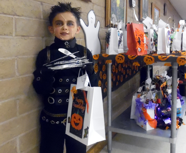 Donovan Knap, 6, dressed as Edward Scissor Hands, won first place in his division of the costume contest at the Family Fun Night Friday hosted by the Senior Center of Boulder City. Hunter Terry/Bo ...