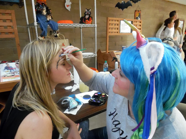Sara Hoffman, from Las Vegas, had her face painted by Kristen Byers, of Boulder City Friday at the Family Fun Night, hosted by the Senior Center of Boulder City. Hunter Terry/Boulder City Review