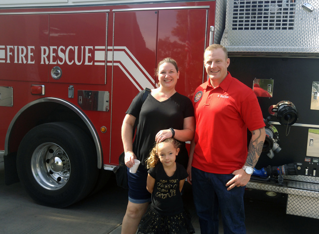 Hunter Terry/Boulder City Review Rosalind Ripley and her 4-year-old daughter, Sienna, of Henderson enjoyed a tour of the fire department and the fire engines from Boulder City Firefighter Josh Bar ...