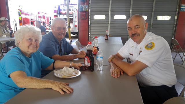 Hunter Terry/Boulder City Review Dorothy and Jack Rants chat with Division Chief of Operations Chuck Gebhart about the great people at the fire department and the Rants' 82 years in Boulder City d ...