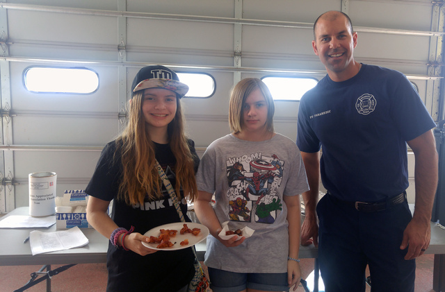 Hunter Terry/Boulder City Review Joy, left, and Jennifer Huff picked up breakfast from firefighter/paramedic Brian Artino on Saturday at the annual open house and pancake breakfast, hosted by the  ...