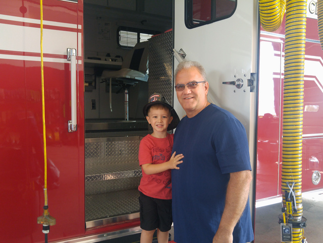 Hunter Terry/Boulder City Review Cooper Crossland, 3, and Bob Schuster, whose son Danny is a firefighter, enjoyed pancakes, bacon and touring the fire station Saturday during the annual firefighte ...