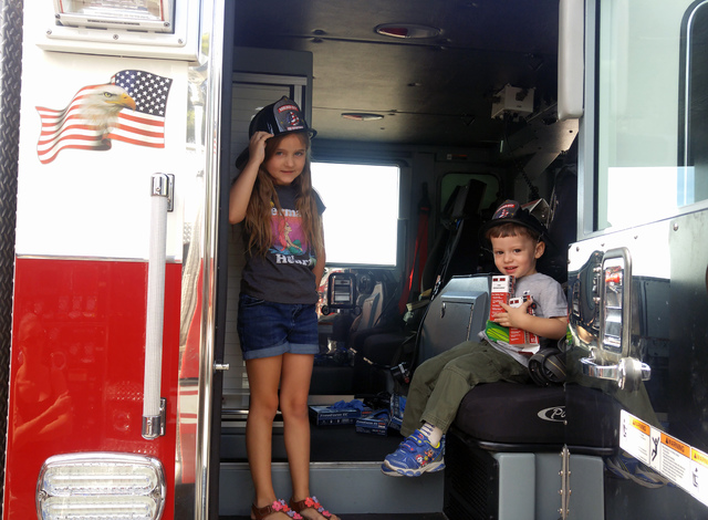 Hunter Terry/Boulder City Review Alex Radan, left, and Riley O'Connor explored the fire engines after enjoying syrup-soaked pancakes at the annual firefighters pancake breakfast Saturday at the Bo ...