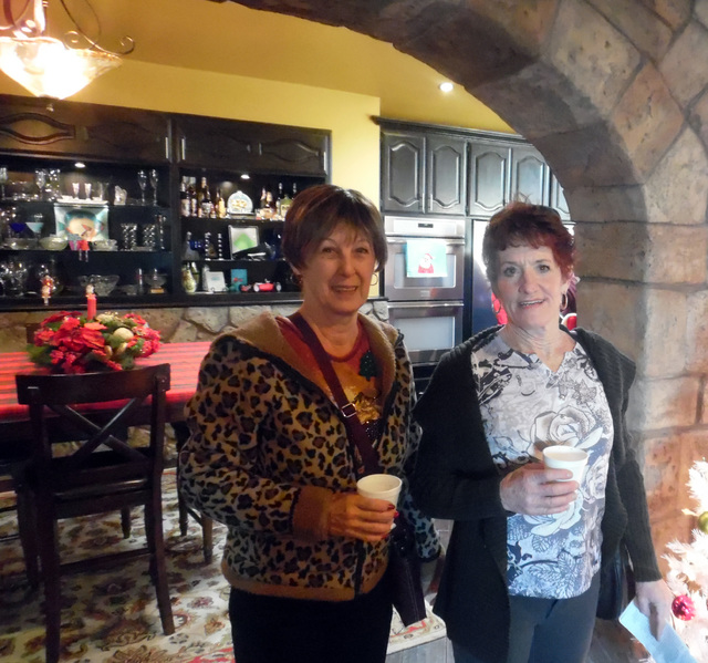 Hunter Terry/Boulder City Review Susan Steinert, left, and Lynn Masters, both from Boulder City, loved taking in the expansive views and exploring the beautiful homes featured on the American Asso ...