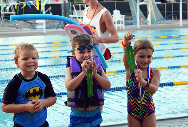 Five-year-olds, from left, Lee Sheldon, Drew Huysentruyt and Taylor Reeves show off their medals after racing their boats during the Boulder City Parks and Recreation Departments 16th annual Cardb ...