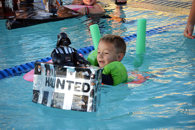 Colton Arioste, 4, paddles his Darth Vader boat to the finish line at the Boulder City Cardboard Boat Race on July 20. Colton didn't win the race but he finished with a smile. Max Lancaster/Boul ...