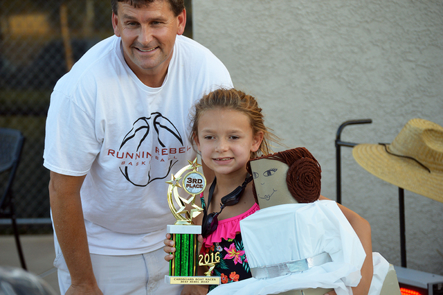 Mekenzie Martorano, 7, is presented the third-place trophy for best Rebel boat by Mayor Rod Woodbury during the parks and recreation department's 16th annual Cardboard Boat Race on July 20. Mekenz ...