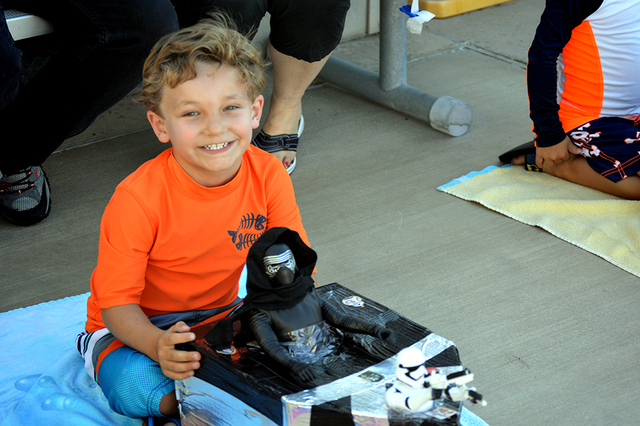 Cash Arioste, 5, shows off his Imperial boat with Kylo Ren as the pilot. Cash's boat made it safely across the pool during the 16th annual Cardboard Boat Race at the city's municipal pool. Max Lan ...