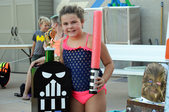 Mikayla Martorano, 10, smiles in front of her award. Mikayla won third place for best Imperial boat during her first year participating in the parks and recreation department's 16th annual Cardboa ...