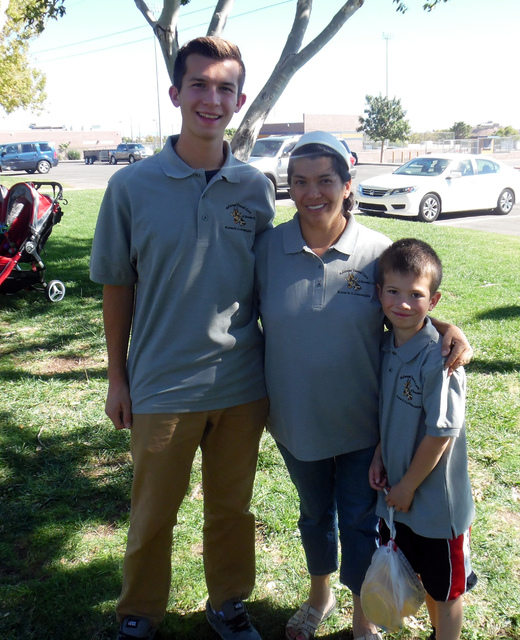 Hunter Terry/Boulder City Review Daniel, Ruth and 7-year-old Jared Clothier enjoyed food and games with family and community members at Advanced Dental Care's thank you picnic celebrating Dr. El ...