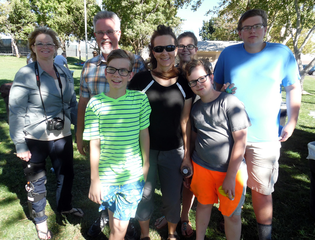 Hunter Terry/Boulder City Review Shauna Kelley, from left, along with Victor, John, 13, Cora-Lee, Joy, 15, Josh, 11, and Jesse Miller celebrated Advanced Dental Care's 40th anniversary at Dr. El ...