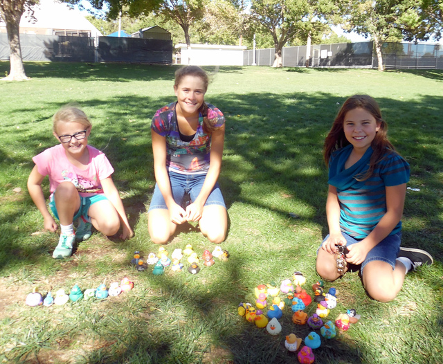 Hunter Terry/Boulder City Review Emily Traasdahl, 8, from left, Olivia Mikkelson, 14, and Lillian Mikkelson, 10, took home a bounty of aquatic prizes after playing games at Dr. Eldon Clothier's  ...