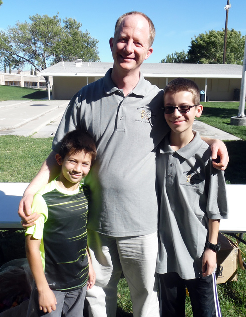 Hunter Terry/Boulder City Review Benjamin, 10, from left, Curtis and Andrew Clothier, 12, visited from Lehi, Utah, to celebrate Dr. Eldon Clothier and his office's 40 years in Boulder City at Ad ...