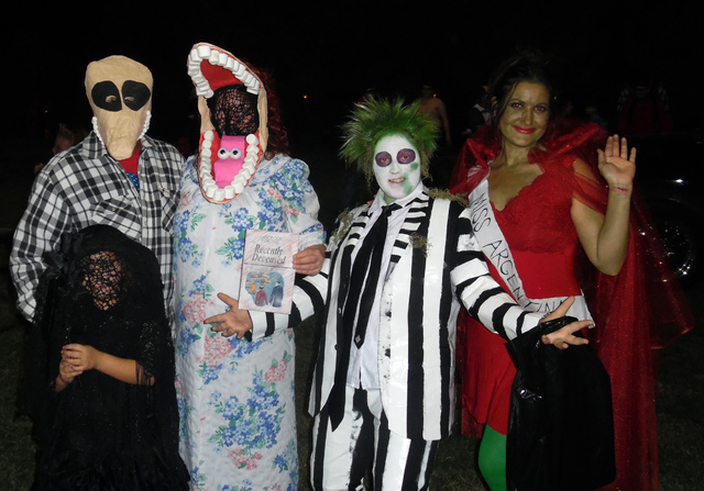 """Hunter Terry/Boulder City Review Steven, from left, Sophie, 7, Jessica and Taylor Strange teamed with Carie Vogel to complete their """"Beetlejuice"""" theme, which was named the best of the group/famil ..."""