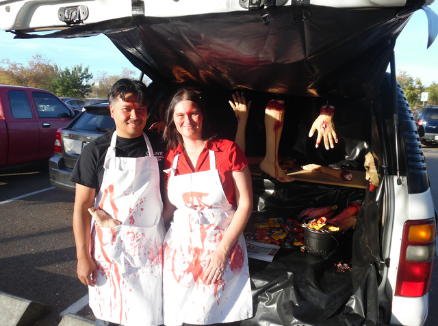 Hunter Terry/Boulder City Review David and Tracie Polak represented the Boulder Dam Credit Union as they passed out candy from their gore-filled trunk Saturday at Trunk or Treat in Veterans' Memor ...