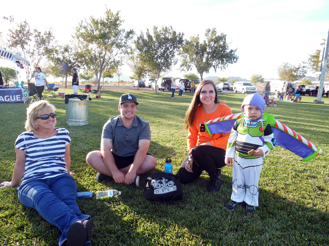 Hunter Terry/Boulder City Review Lois Czarniak, Kirk Czarniak, Bailey Hagen and 2-year-old Brayden Gutierrez arrived early to celebrate Halloween at Trunk or Treat on Saturday in Veterans' Memoria ...