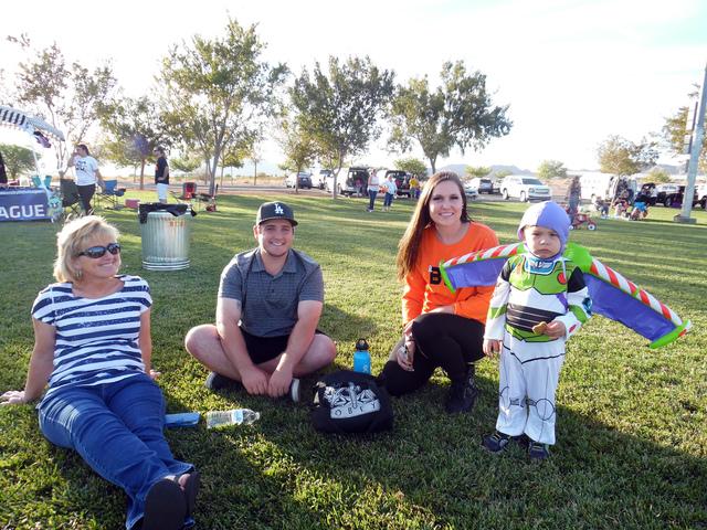 Hunter Terry/Boulder City Review Lois Czarniak, Kirk Czarniak, Bailey Hagen and 2-year-old Brayden Gutierrez arrived early to celebrate Halloween at Trunk or Treat on Saturday in Veterans' Memoria ...