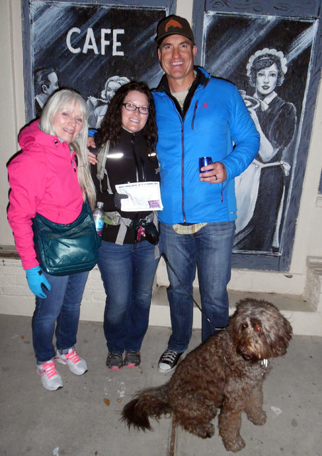 Hunter Terry/Boulder City Review Mary LeMahieu of Duluth, Minnesota, left, explored Boulder City with locals Rachel LeMahieu and Justin DeBeaumont during the Saturday's wine walk.