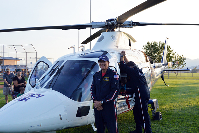 Mercy Air lead helicopter pilot Mike Siemers smiles in front of his rescue chopper during National Night Out. Kids at the event loved the helicopter and couldn't wait to sit in the pilot's sea ...