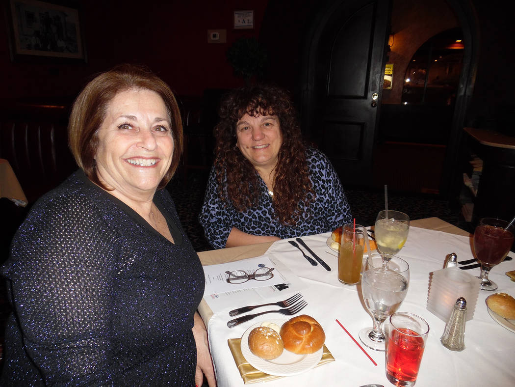 Hali Bernstein Saylor/Boulder City Review Jeanne Donadio, left, a past president of the Rotary Club of Boulder City, visits with Barbara Agostini during the service organization's 80th anniversary ...