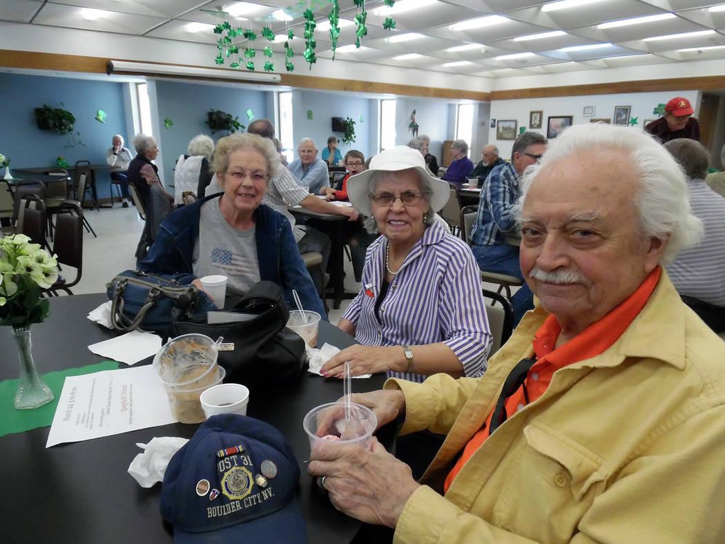 Hali Bernstein Saylor/Boulder City Review Enjoying a sweet treat during the Senior Center of Boulder City's ice cream social Saturday were, from left, Ronda Belleau, Helen Green and Jack Belleau.