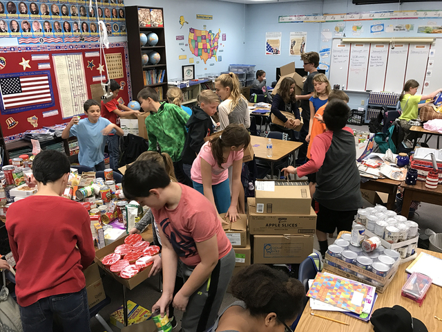 Courtesy photo More than 1,000 pieces of food were collected by King Elementary School fifth-graders to be donated to local food pantries, including Emergency Aid of Boulder City and Christian Cen ...