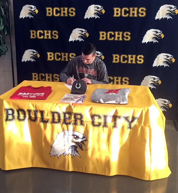 Photo courtesy Amy Wagner Boulder City High School senior Taylor Hatchel recently signed his letter of intent to play football for Hastings College in Hastings, Nebraska.
