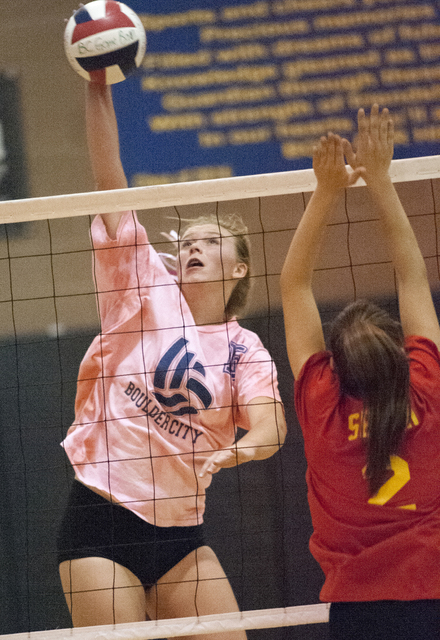 Steve Andrascik/Boulder City Review Boulder City High School volleyball player junior Maggie Roe slams the ball over the net in the match against Southeast Career Technical Academy on Tuesday. The ...