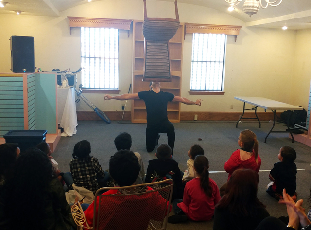 Hunter Terry/Boulder City Review Strip performer Jeff Civillico performed for the kids at the St. Jude's Ranch for Children on Saturday, balancing a variety of objects, including a chair, on his chin.