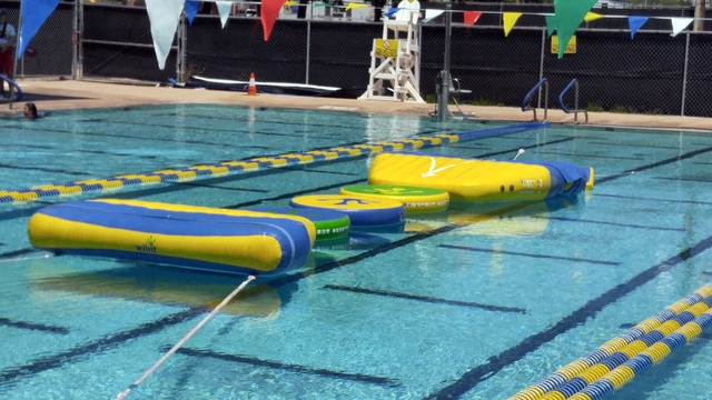 The Boulder City Pool added a new atttraction this year with the wiggle bridge, a floating obstacle course, inside the pool and racquetball complex at 861 Avenue B. Hunter Terry/Boulder City Review