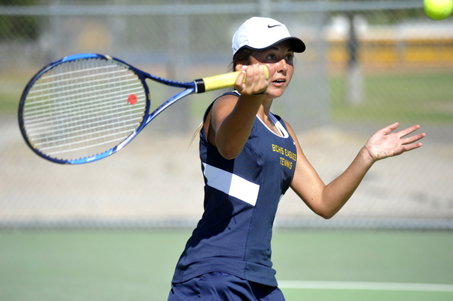 Steve Andrascik/Boulder City Review Boulder City High School tennis player Tegan Pappas keeps her eye on the ball as she prepares to return it to her Moapa Valley opponent during the home match Se ...