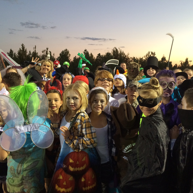 Hali Bernstein Saylor/Boulder City Review Boulder City Chamber of Commerce CEO Jill Rowland-Lagan was surrounded by children as the costume contest got underway during Trunk or Treat festivities S ...