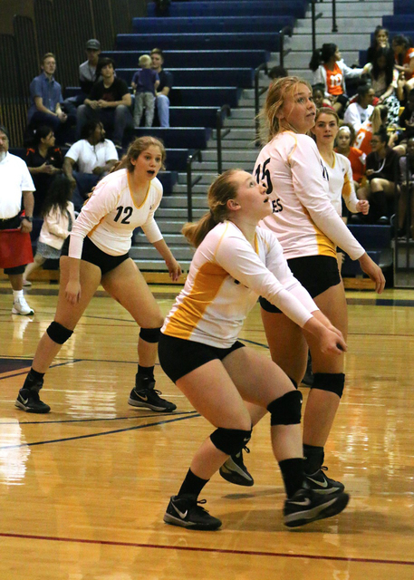 Laura Hubel/Boulder City Review Team work, as demonstrated by Courtney Blumenthal, from left, Alea Lehr, Maggie Roe and Kenadee Bailey during Boulder City High School's Lady Eagles' Oct. 26 win ov ...