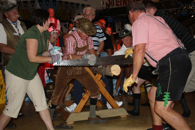 Photo courtesy Deborah Wall  Log sawing is just one of the competitions that visitors can take part in at the 46th annual Oktoberfest, which runs Saturdays and Sundays through the end of October.
