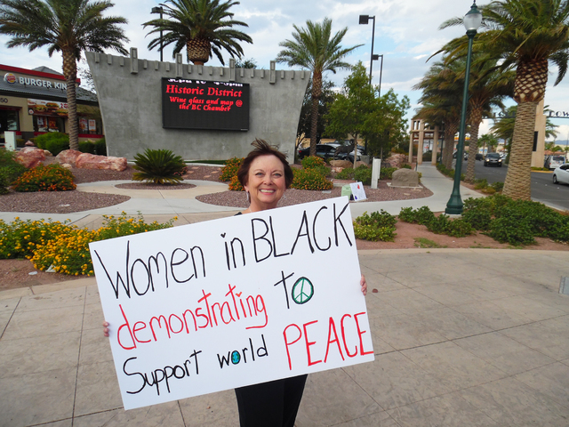 Patty Jacobson participated in the Women in Black protest against violence Friday, Aug. 26, 2016. The protests will be held the fourth Friday of every month. Hunter Terry/Boulder City Review