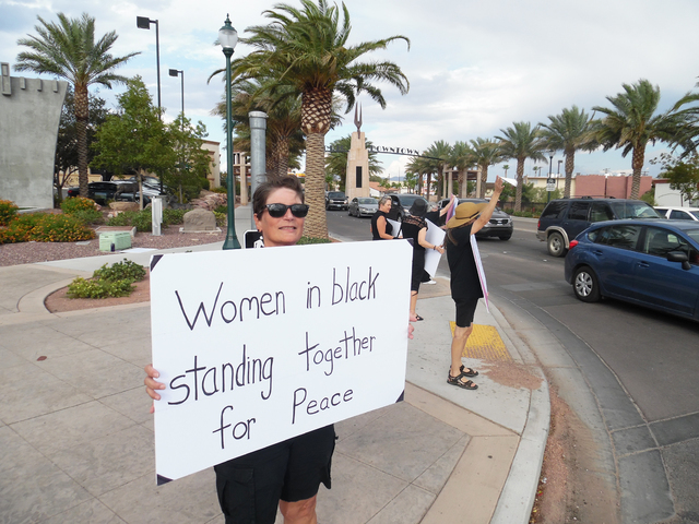 Kay Benge protested violence as a member of the Women in Black in downtown Boulder City Friday, Aug. 26, 2016