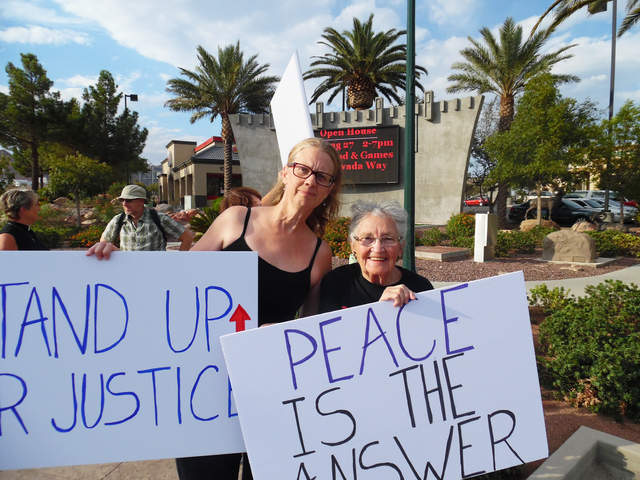 Heather Gaylord, left, and Shirley Putz protested violence as part of the Women in Black on Friday Aug. 26, 2016, in downtown Boulder City. Hunter Terry/Boulder City Review