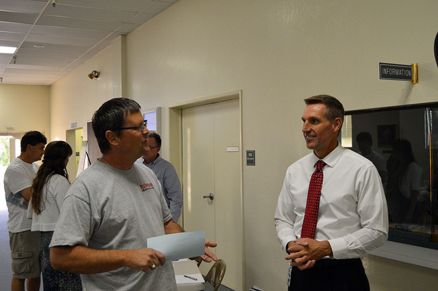 Max Lancaster/Boulder City Review  Boulder City resident Dennis Maring, left, talks to Public Works Director Scott Hansen about utility rate increases at a public workshop on Oct. 5. Maring said h ...