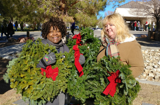 Hunter Terry/Boulder City Review Sandra Grene-Robinson, left, and Lori Franklin attended the Wreaths Across America ceremony Saturday at Southern Nevada Veterans Cemetery as representatives of Cap ...