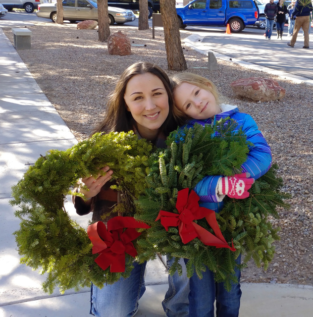 Hunter Terry/Boulder City Review Autumn Webster, left, and Skyler Fulde came to Boulder City from Las Vegas to attend the Wreaths Across America ceremony at Southern Nevada Veterans Cemetery and p ...